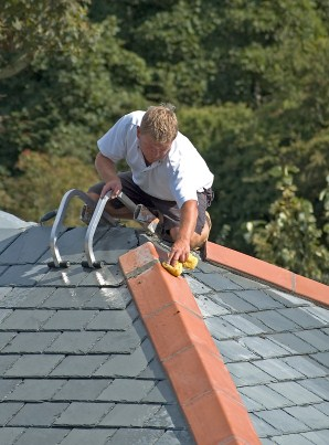 Roofer installing slate roof in Livingston, TX.